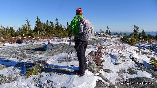 The Baldface Circle Trail continues over open ledge to Eagle Crag where it descends to Rt 113