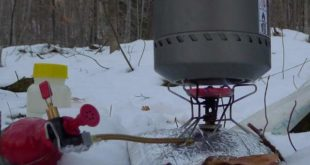 Red hot glow of a MSR Whisperlite Stove melting snow on full power