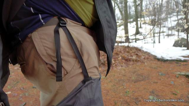 The rain chaps clip to your belt or pant's waist, which helps keep them up