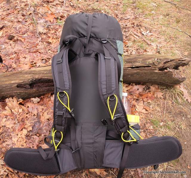 The Ohm 2.0 has lots of places to attach gear to the shoulder straps, including yellow elastic cords that you can wrap around water bottles to keep them handy