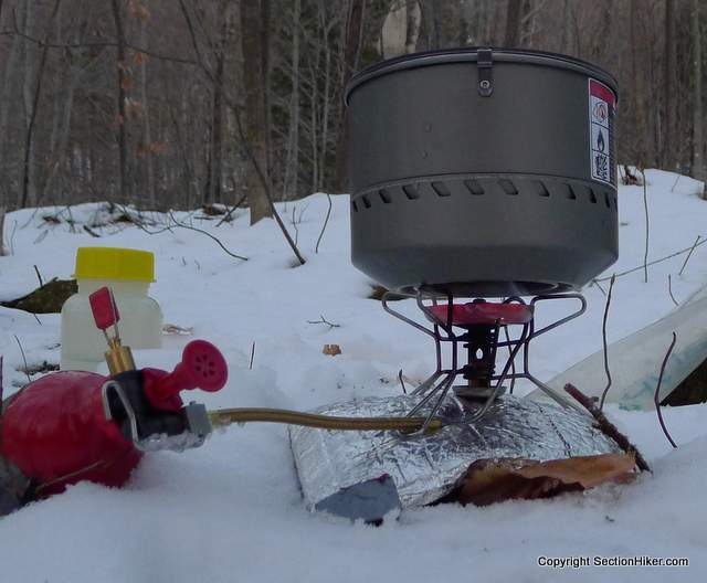 Red hot glow of a MSR Whisperlite Stove melting snow on full power : best winter backpacking tent - memphite.com