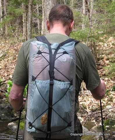 Some backpacks have tie out loops that let you rig up custom cord systems for attaching gear to the rear of your pack.Pack Shown: Mountain Laurel Designs Newt (I think!)
