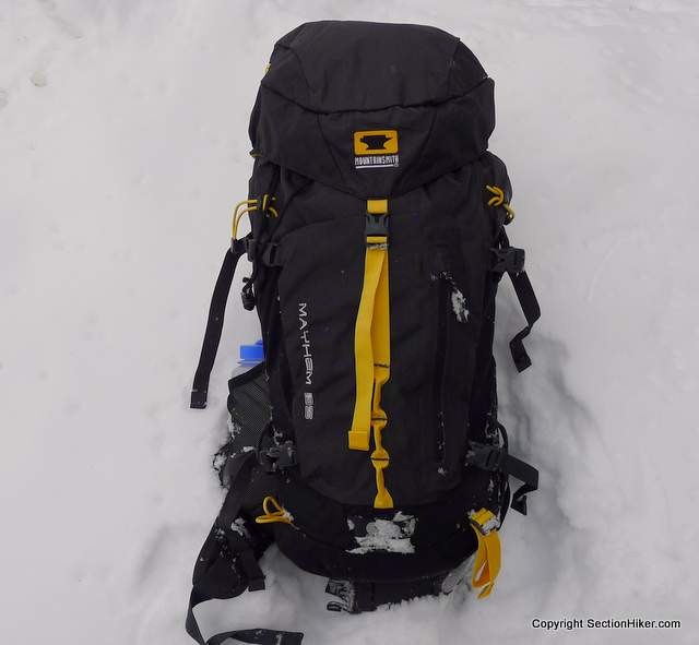 The Mountainsmith Mayhem 35L backpack has a top lid that secures to the pack body with a single strap.