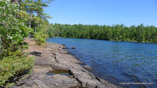 The Five Finger Point Natural Area lies as the base of the Rattlesnakes and provides access to the lake below. A trail runs along the waters edge with access to sand beaches and swimming