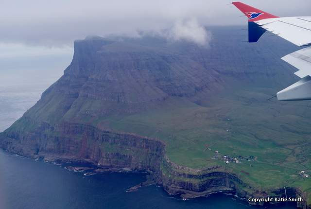 View of Gasadalur and its iconic waterfall from the air.
