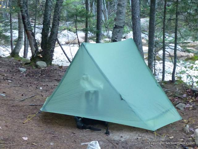 While the tent fabric is translucent, you really can't see into the tent in daylight unless items are flush against the fabric