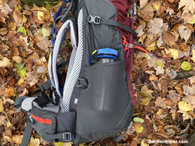 The bottom compression strap can be routed under a bottle in the side pocket.