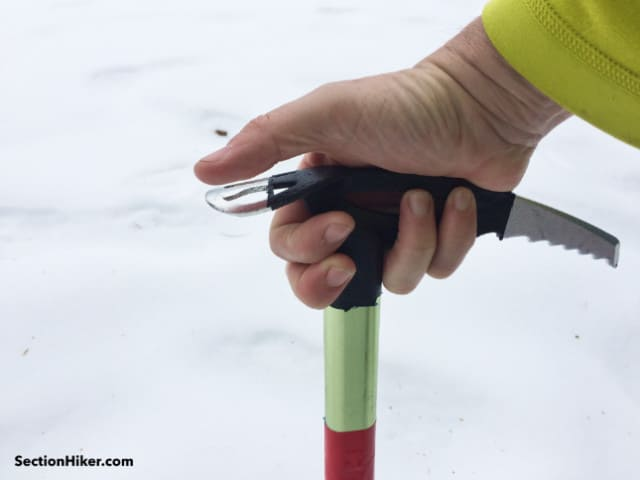 The insulated ice axe head can be barehanded in warmer weather or gripped with a lightly insulated glove
