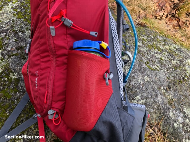 The Trail 30 has one open side pocket and one that zippers closed.