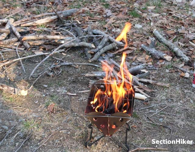 """The Mini Flatpack Grill is only 9"""" long, so you'll need to break downed wood into small lengths unless yoiu use bagged Briquettes or Charcoal."""